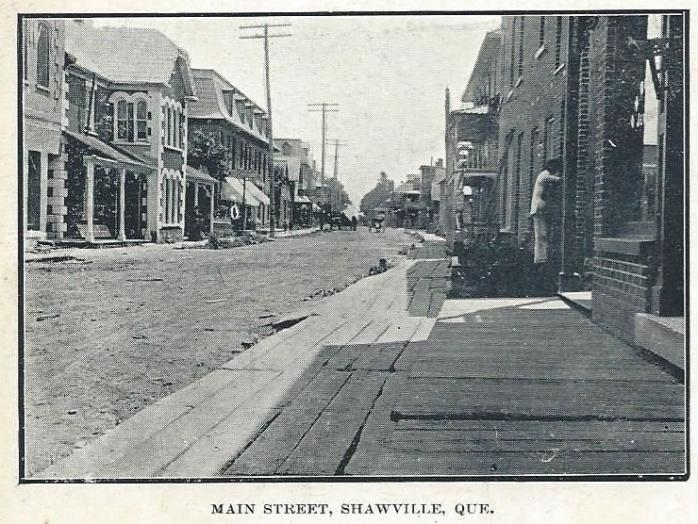 Very early postcard from Shawville, Quebec, c.1900. Note the brick storefronts, typical of Shawville, and the wooden plank sidewalks that were designed to protect pedestrians from the dust and mud of the street.