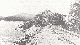 Passenger train coming through the rock cut at Blue Sea Lake, 1917. (Photo - GVHS)