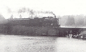 Steam engine crossing the trestle bridge south of Farm Point. (Photo - GVHS)