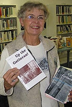 Editor Carol Martin shows off the latest issue of Up the Gatineau! (Photo - Matthew Farfan)