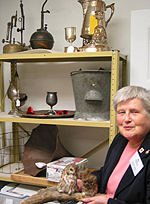 Volunteer Pat Drew with some of her favourite artifacts. (Photo - Matthew Farfan)